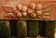 Flower pattern on brick in garden Stock Image