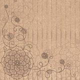 Flower pattern on cardboard in the style grunge. Royalty Free Stock Photo