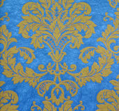 Flower pattern. East style golden flower pattern with blue background Royalty Free Stock Image
