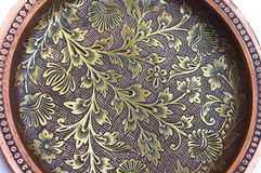Flower pattern filigree work. Background of intricate flower pattern filigree (inlay) work on metal Stock Image