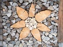 Flower pattern in firewood betwen posts Stock Photos