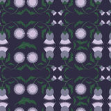 Flower pattern. The flowers are a thistle in a pattern on a purple background Royalty Free Stock Photo