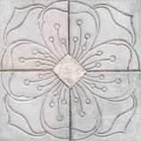 Flower pattern graven Gray Tile. Cements on the floor Royalty Free Stock Image