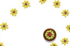 Flower pattern made up of dried red beans and half green peas. Beautiful flower pattern made up of dried red beans and half green peas isolate on white stock illustration