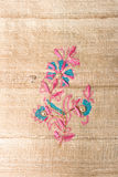 Flower pattern on silk Stock Images