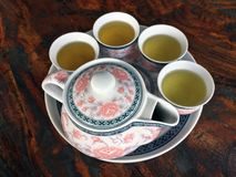 Flower pattern tea set on wooden table. on top angle. A set of cup and pot, typically of china or ceramic, used for serving tea royalty free stock photos