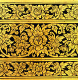 Flower pattern in traditional Thai style art. Painting on window of the temple Stock Photography