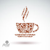 Flower-patterned cup of coffee with aromatic steam. Rendezvous t Royalty Free Stock Images