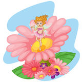 A flower pixie above a big pink flower Stock Images