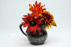 Flower pot. Assorted flower in a creamer against a whit back ground Stock Photography