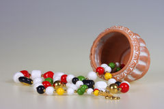 Flower-pot and beads Royalty Free Stock Photo