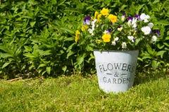 Flowers & Garden. Flower pot with decorative text Flowers & Garden Stock Photography