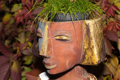 The flower pot. In the form of the feminine head stock photo