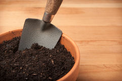Flower pot with garden shovel and soil Stock Images