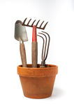 Flower pot with garden tools Royalty Free Stock Photography