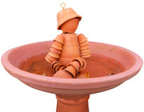 Flower pot man in a Bird Bath Stock Photos