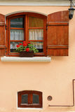 Flower pot. The ornate window from a building in Sighisoara old city Stock Images