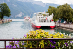 Flower pot over the canals of Annecy, France Stock Image