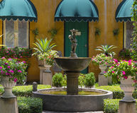 Flower Pot in park. With architecture and fountain Royalty Free Stock Images