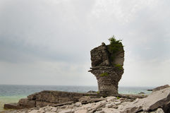 Flower Pot Rock formation lake side royalty free stock photos