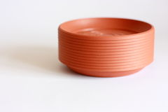 Flower pot saucers. Saucers for the flower pots, standing on white background Stock Photos