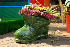Flower pot in shape of shoe with flowers Royalty Free Stock Images