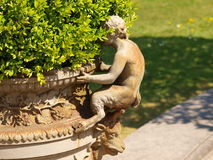 Flower pot with a statue of Satyr Royal Greenhouses Royalty Free Stock Image