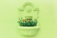 Flower pot on the wall. Flower pot on the green wall Stock Image