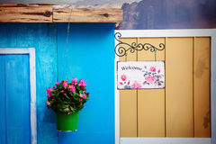 Flower pot and welcome sign Stock Photos