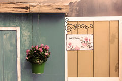 Flower pot and welcome sign Royalty Free Stock Photos