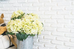 flower in pot with white brick wall background Royalty Free Stock Photos