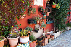 Flower pots at a house wall in Burano Stock Photo