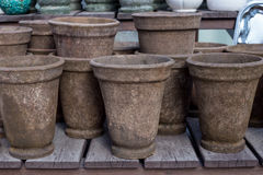 Flower pots. Random piles and stacks of vintage flowerpots. On wooden shelf Royalty Free Stock Image