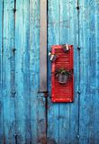 Flower pots on red wooden shutter on an grange blue wall background stock photo