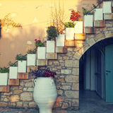 Flower pots on the staircase in old stone house, Crete, Greece Stock Images