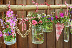 Flower pots on wooden fence Royalty Free Stock Photos