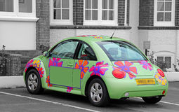 Flower power hippy car. Photo of a funky flower power car in green paintwork.blank space on door for advertising or own text Royalty Free Stock Photos
