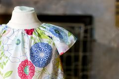Flower power kids dress on antique mannequin Royalty Free Stock Image