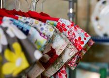 Flower power kids dresses on on hangers Stock Photo