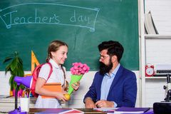Flower present for best teacher. knowledge day is 1 september. small school girl kid with flower. back to school. Happy