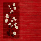 Flower print on Stained red wood. White and black flower print on Stained red wooden slatted background stock images