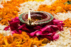 Stock photo of flower rangoli for diwali or pongal or onam. Flower rangoli for Diwali or pongal or onam made using marigold or zendu flowers and red rose petals Royalty Free Stock Photography