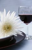 Flower and red wine. Dinner setting with exotic flowers and red wine Stock Photos