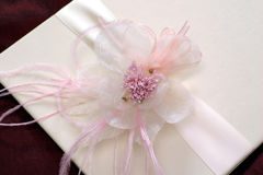 Flower with ribbon. Flower on white card with ribbon Stock Image