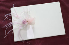 Flower with ribbon. Flower on white card with ribbon Royalty Free Stock Image