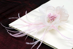 Flower with ribbon. Flower on white card with ribbon Stock Photography
