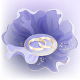 Flower with rings. Wedding background with blue flower and golden rings Royalty Free Stock Photos