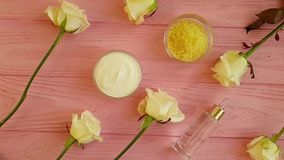 Oil, soap, rose flower natural relax on wooden background treatment stock video