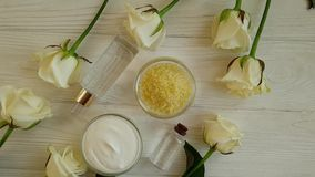 Oil, soap, rose flower relax on wooden background treatment stock video footage