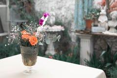 Flower vase in the garden. Flower rose vase in the garden vintage style Royalty Free Stock Images